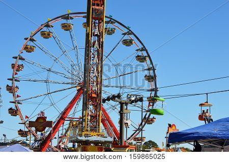 carnival fair blue sky ride midway Ferris wheel