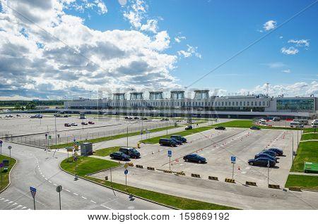 ST. PETERSBURG RUSSIA - JUNE 16 2015: Car Parking and airport terminal Pulkovo