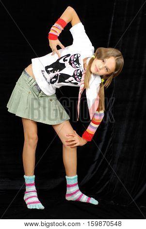 mischievous girl in socks removed in studio