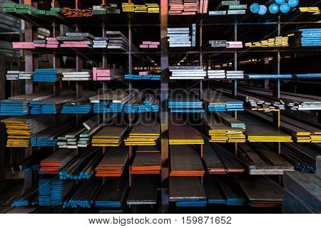 Shelves in DIY store displaying metallic parts for construction