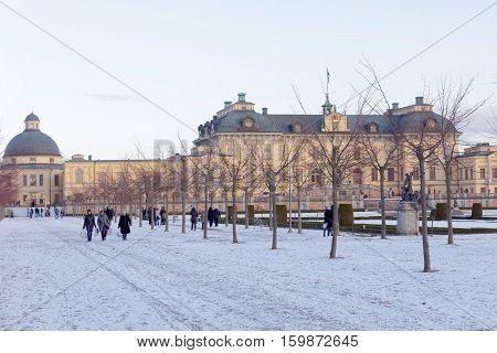 STOCKHOLM SWEDEN - DEC 03 2016: Swedish royal castle Drottningholm during the winter. People walking. Norra bantorget Stockholm Sweden