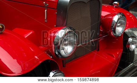 Color detail on the headlight of a vintage car