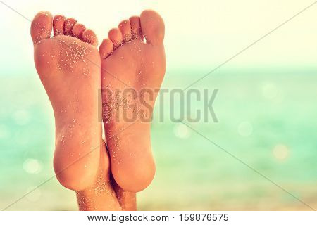 Perfect clean female feet  with sea sand on the beach .   . Spa ,scrub and foot care .