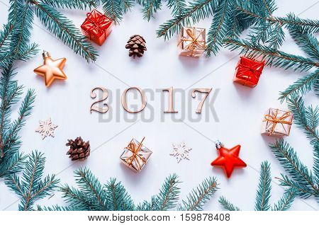 New Year 2017 background with 2017 figures Christmas toys fir branches-New Year 2017 still life. Concept of New Year 2017 holiday with New Year objects. Flat lay top view of 2017 composition