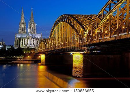 Cologne Cathedral and Hohenzollern Bridge after sunset