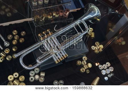 Vintage toy trumpets at market. Musical instruments