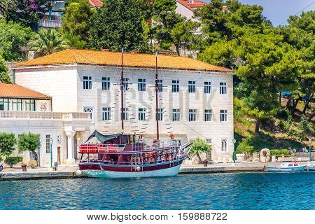 Waterfront view at stonemasonry school in small town Pucisca, Croatia Europe.