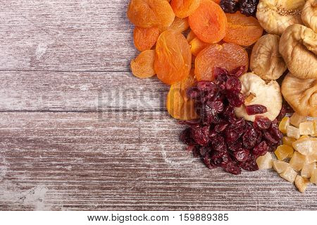 Different Type Of Dried Fruits On Wooden Table