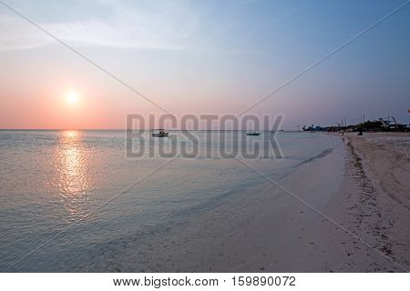 Fishermans Huts on Aruba island in the Caribbean Sea at sunset