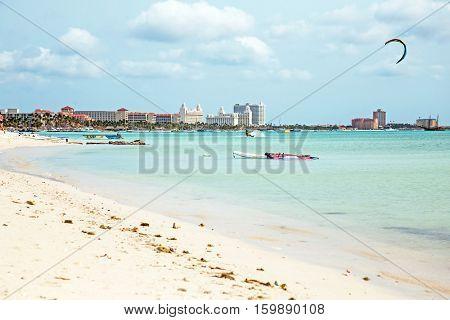 Kite surfing on Palm Beach on Aruba island in the Caribbean Sea