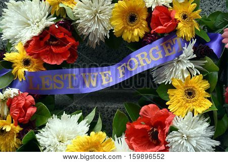 Colorful fresh floral wreaths for Anzac Day memorial celebrations to honor and remember those who gave their lives in battles