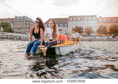 Young People On Pedal Boat In Lake
