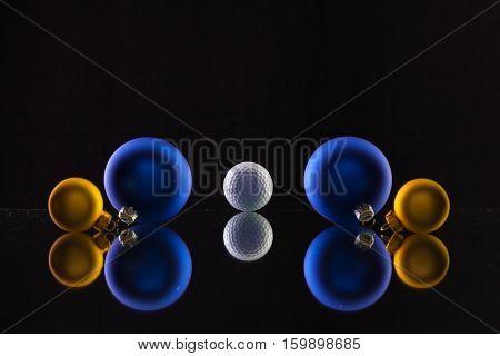Golf ball and Christmas decoration on the glass table