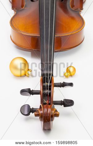 Old violin and Christmas decoration on the white background