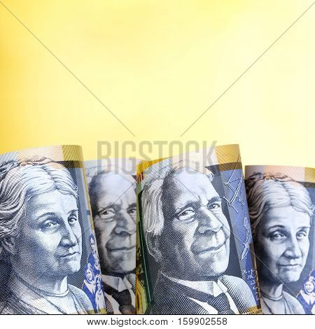 Australian money background.  Fifty dollar notes against golden background,
