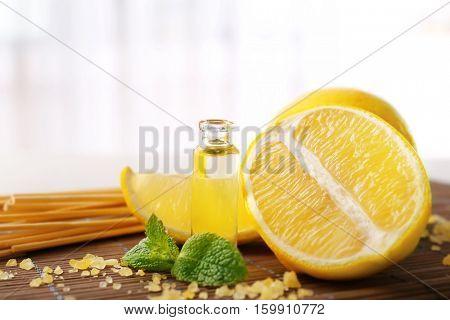 Beautiful spa composition with lemon essential oil, closeup