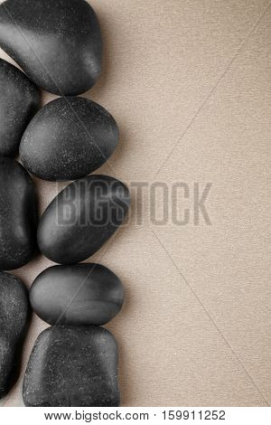 Spa stones on color background