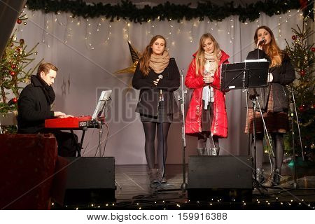 POLAND SOPOT - DECEMBER 14 2014: An unknown youth group performs catholic Christmas songs in anticipation of New Year holidays.