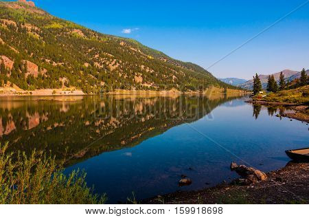 San Cristobal Lake reflections in the water on a nice Canoe time on the lake sunrise morning alpine glow tranquil morning on the nature trail of Lake City Colorado USA