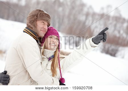 Young woman showing something to her boyfriend