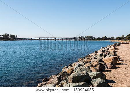Rocky shoreline on Mission Bay in San Diego, California.