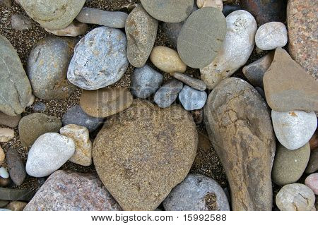 closeup of pebbles on wet sand