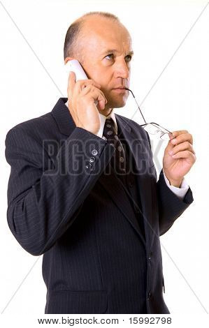businessman holding glasses and talking on the cellphone. isolated on white