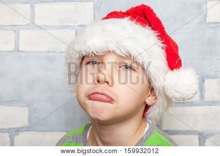 Cute Little boy with a Santa hat