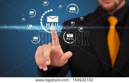 Businessman pressing messaging type of modern icons with virtual background