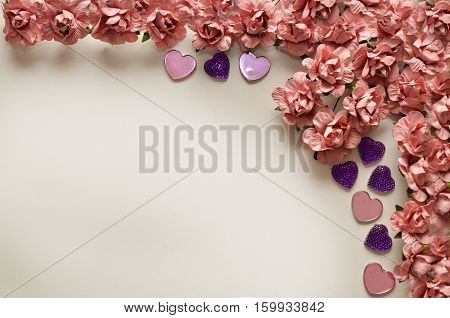 beautiful card for the holiday of love. Background for Valentine's Day. Postcard for weddings. Pink flowers on a white background scattered small hearts.