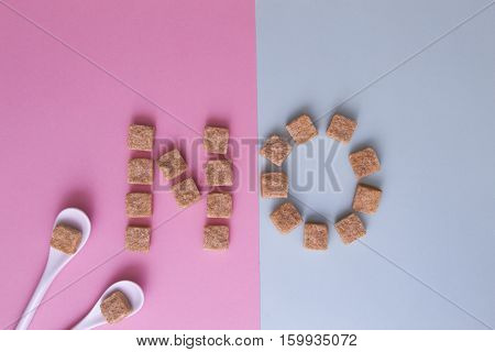 Sugar cubes arranged as word NO on white background. Top view. Diet unhealty sweet addiction concept