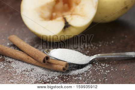 apples with sugar and cinnamon preparing for baking