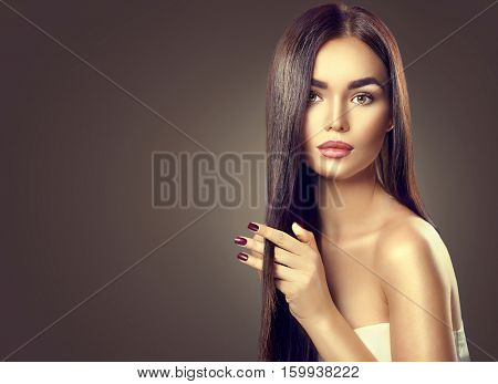 Beautiful long Hair. Beauty woman with luxurious straight black hairon dark background. Beautiful brunette Model girl touching Healthy Hair. Lady with long smooth shiny straight hair. Hairstyle, cure.