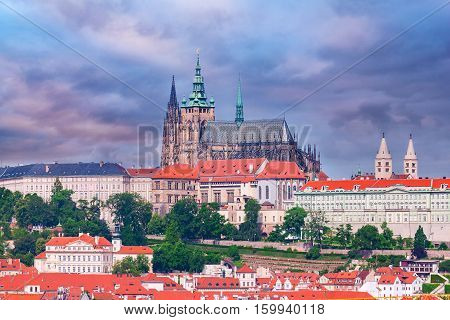 Panoramic view of St. Vitus Cathedral and Castle in Prague, Czech Republic. Beautiful dramatic picture in pink colors