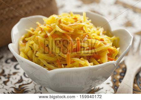 Bowl with pickled indonesian atjar tjampoer