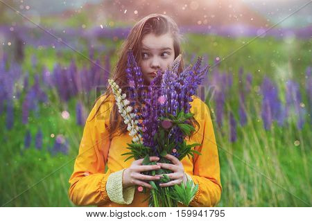 Girl With A Bouquet Of Lupines In A Field In The Rain..