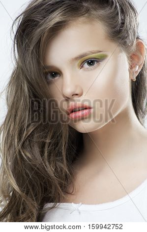 Beauty Portrait Of A Young Girl With Bright Makeup And Long Hair..