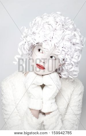 Portrait Of Charming Girl In A White Fur Coat And Mittens..
