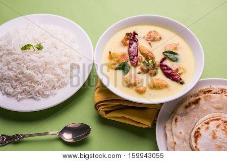 North India's popular food Kadhi Pakoda or kadhi pakora with laccha paratha or roti and cooked basmati rice