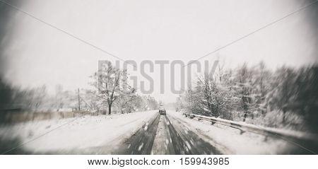 Blured winter asphalt road