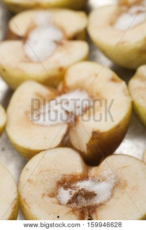 apples with sugar and cinnamon prepared for baking on a frying pan