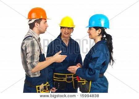 Three Constructor Workers Having Conversation