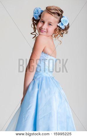portrait of cutie girl in blue dress