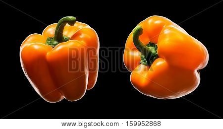 Sweet orange pepper isolated on black background