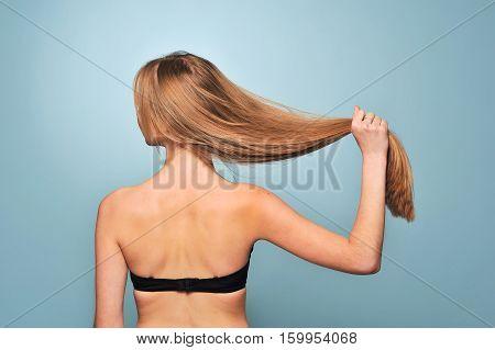 Girl In Black Bra Showing Their Long Hair
