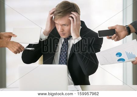 Young businessman, multitasking boss, paying attention to trivial details, poor time-management, driving crazy with a lot of duties, ineffective human relations, lack of skill