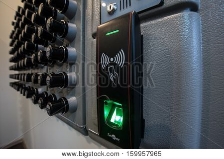 Saint-Petersburg Russia - November 22 2016: Automated storage and dispensing keys on inputted code and fingerprint in the form of a wall panel on the checkpoint enterprise