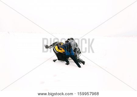 The sportsman on a snowmobile. Winter sports.