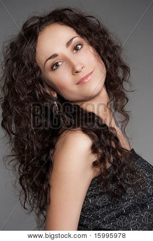 pretty young woman with beautiful long curly hair