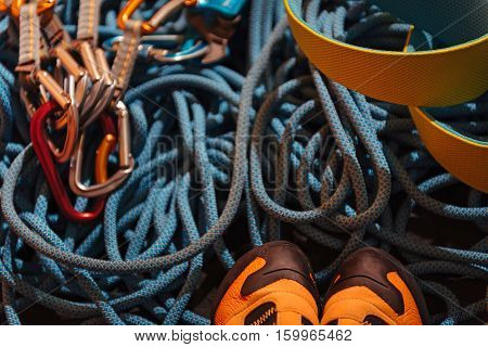 Ready for it. Close up of boots for climbing and insurance ropes as special equipment.